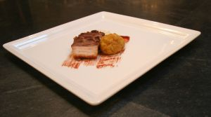 Fried matzo ball served with Manischewitz wine-glazed pork belly and Jerusalem artichoke puree.